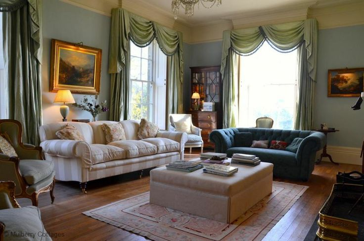 Relax in the grand drawing room at The Old Rectory, a stunning large holiday home in Sussex.