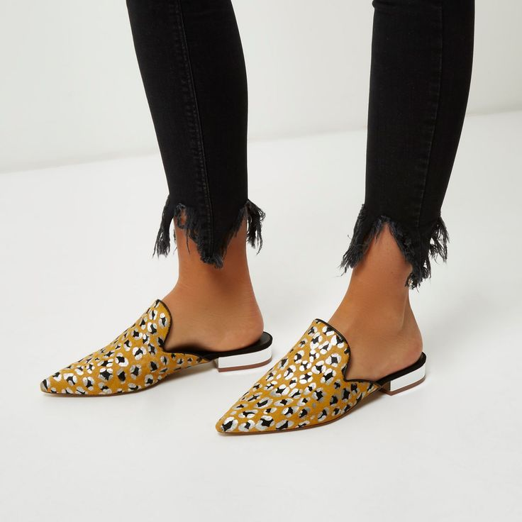 Textured pony hair upper Printed metallic detail Backless design Slip on style Pointed toe