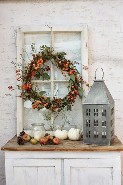 great autumn decoration with old window, zinc lantern and wreath