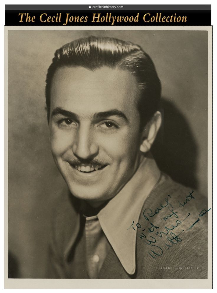 "Walt Disney - Rare photograph signed to his brother Ray. (ca. 1930s) Vintage original gelatin silver 7.6 x 9.75 in. double-weight semi-gloss photograph by Clarence Sinclair Bull signed by Disney boldly in green ink in the lower right of image to his brother, ""To Ray, with my best wishes, Walt"". NOTE: This brother is Ray not Walt's better known brother Roy. Ray was an insurance executive that sold the insurance to the Disney empire."