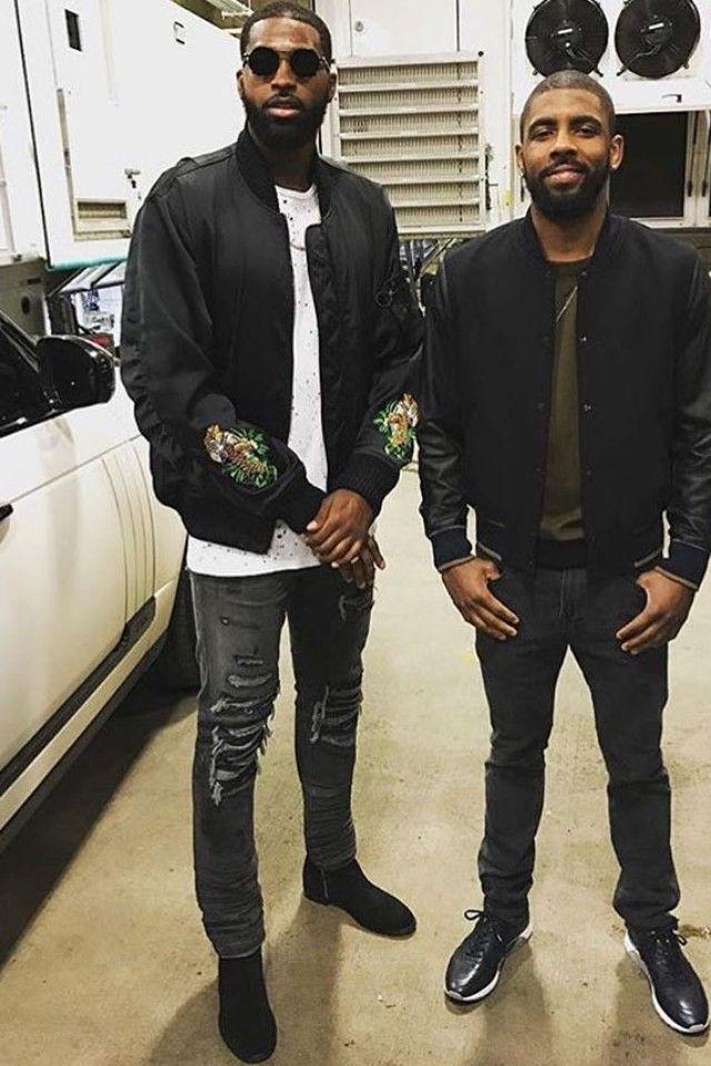 Tristan Thompson wearing  Amiri Stack Boots, Off-White c/o Virgil Abloh Tiger Embroidered Jacket, Amiri Leather-Detail Destroyed Jeans