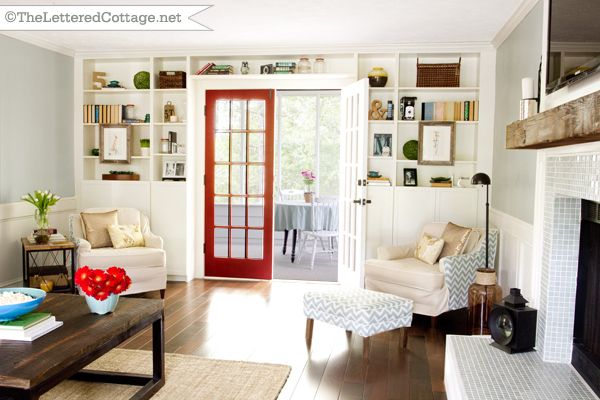 colorful room, but not over the top...love it!: Red Doors, The Doors, Popular Paintings Color, Living Rooms, Heirloom Red, Built In, French Doors, Wall Color, Leather Totes