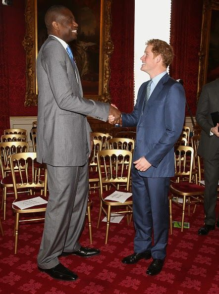 Prince Harry meets NBA global ambassador Dikembe Mutombo during a Coach Core Graduation event at St James's Palace on 14.01.2015 in London, England