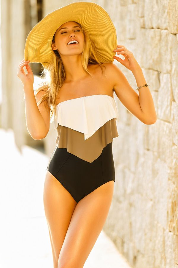Glammed Up One Piece Swimsuit | Eco Swim. Bring glamour and sophistication to every shore line in this beautiful one piece! Strapless bathing suit with color block tiered ruffle over a solid black bodice creating a sleek and feminine silhouette. Beautiful and fashion forward using recycled and renewable materials.