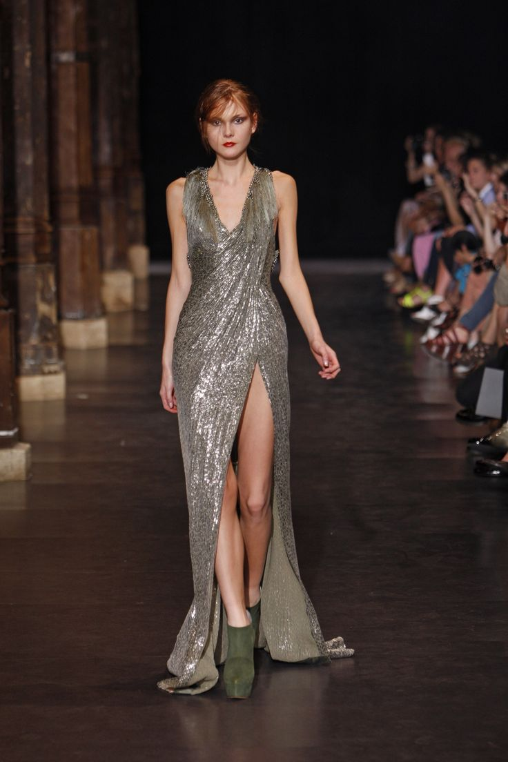 Floor length couture gown with a slit