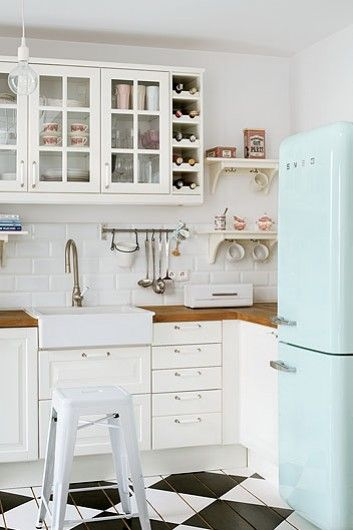 Kitchen- country style kitchen with a difference- eggshell blue SMEG fridge & black + white checkered flooring