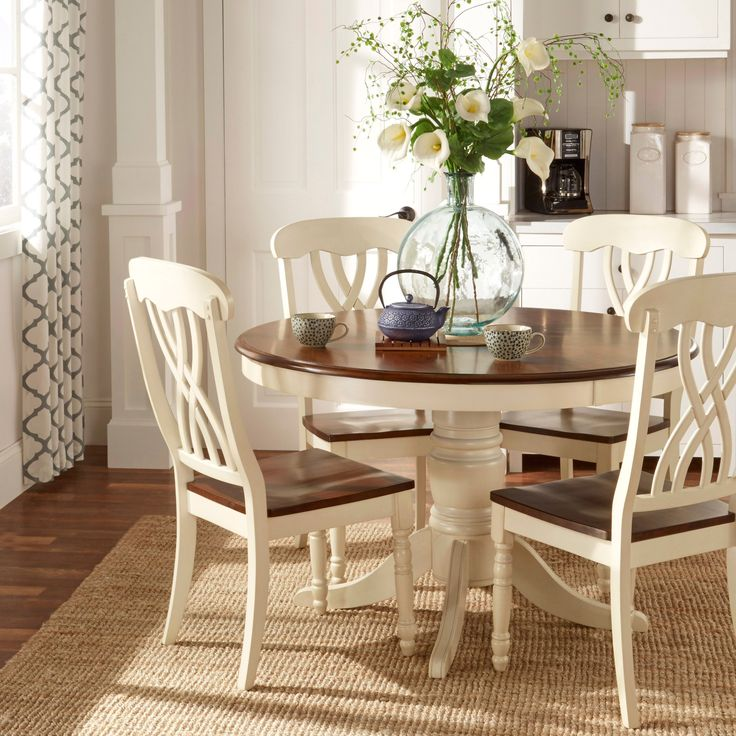 This charming set of chairs would make a lovely addition to the country style furniture in your home. Crafted of solid hardwood with a two-tone finish, these curve-backed chairs are as comfortable as they are stylish.