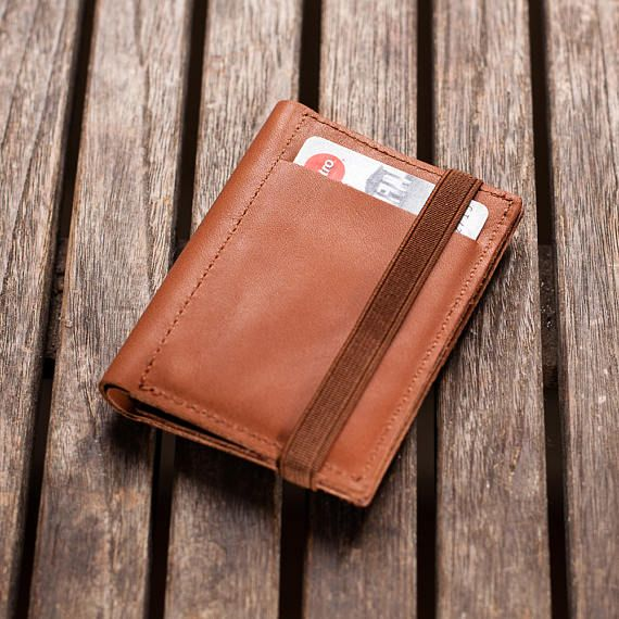 Leather wallet, Limited Edition, No. 05 out of 09  This Men Wallet is handmade to perfect minimalist style. Slim and compact slips easily into your pocket, yet holds all your cards, cash and coins.  Each one of our leather wallets are made from reclaimed leather, off-cuts from high quality furniture workshops, where leather is always carefully selected for beauty and durability. We use the imperfections in the texture or color as a design element, an important part of the 'one of a kind'…
