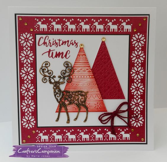 8 x 8 card made using Sara Signature Scandinavian Christmas Collection – Danish Deer die, Swedish Snowflake die, Dashing Deer die, Christmas Time die, Contemporary Folk embossing folder, Traditional Folk embossing folder and Bakers Twine. Designed by Marie Jones #crafterscompanion