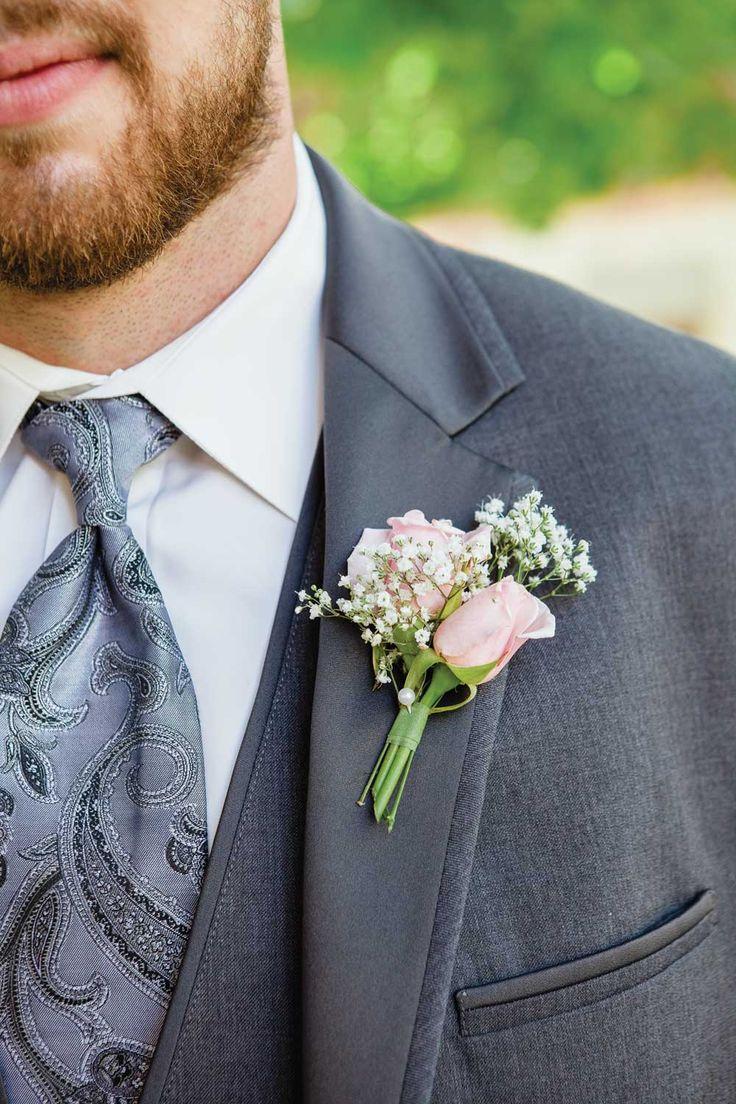 elegante de la vendimia de la boda-flor en el ojal
