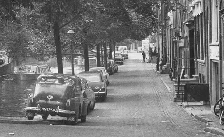 "1960's. Volvo Katterug PV 544 (HN-17-50) on the Brouwersgracht in Amsterdam; then from front to back Ford Taunus 17M 'Barocktaunus', Opel Caravan [P2], unknown, BMW ""Neue Klasse"" (1500, 1600 or 1800), Citroën 2CV, Wartburg 1000 and a Peugeot 404. Photo Archief van de Dienst Ruimtelijke Ordening #amsterdam #1960 #brouwersgracht"