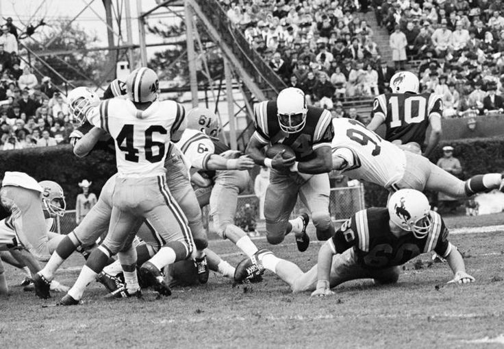 #Black14 University of Wyoming fullback Tom Williams runs the ball against LA State on Jan. 1, 1968 in New Orleans. Before he dismissed the 14 black players, Head Coach Lloyd Eaton of Wyoming had won 3 consecutive Western Athletic Conference championships in the 3 previous years; had 31/36 wins & the UW team was undefeated during the 1967 regular season, ranked 12th (UPl coaches poll), & led the nation in rushing defense. After Eaton dismissed them, his career never recovered.