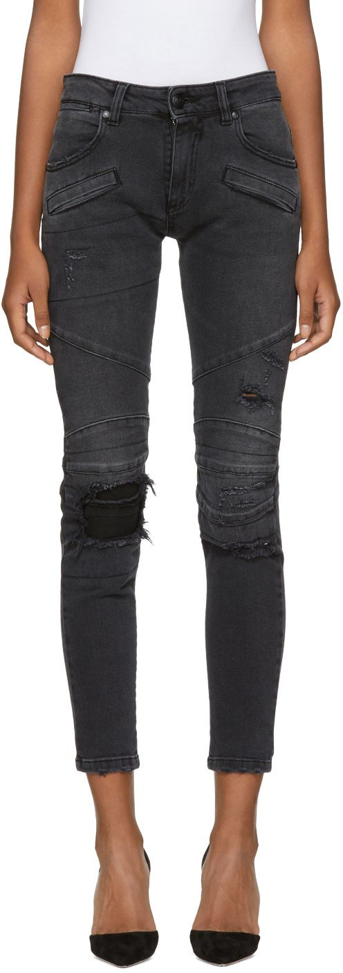 """Pierre Balmain - Black Distressed Biker Jeans.  Skinny fit panelled stretch denim jeans in black. Low rise.  Fading and distressing throughout.  Seven pocket styling.  Tonal denim underlay at knees.  Tonal leather logo patch at back waistband.  Zip fly.  Tonal Hardware.  Approximately 5"""" leg opening.  Made in Italy."""