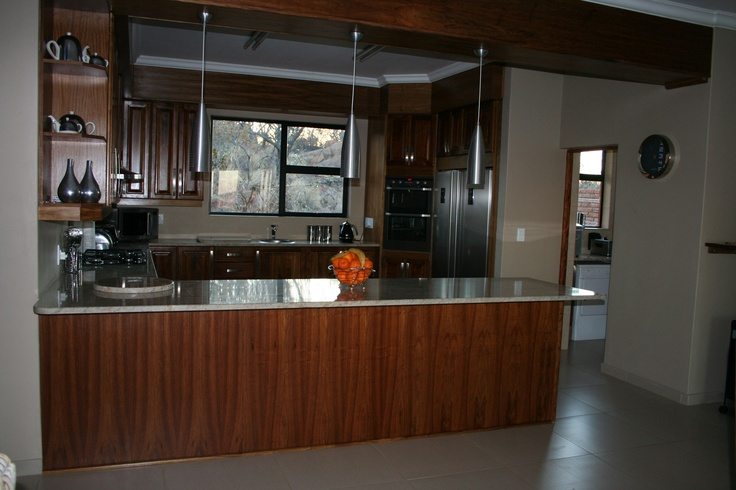 Kitchen thru to scullery and pantry, solid kiaat wood and granite tops. AEG gas stove and electric oven