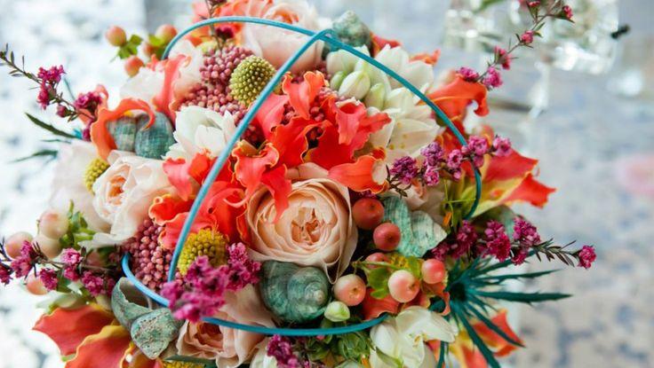 Exotic wedding bouquet. #peachwedding #redwedding #gloriosalily #riceflower #julietgardenrose #ornithogalum #craspedia #leptospermumflower #tealseashells #weddingseashells #tealwedding #nutmegflowers @nutmegflowers photo by: @carascophotography
