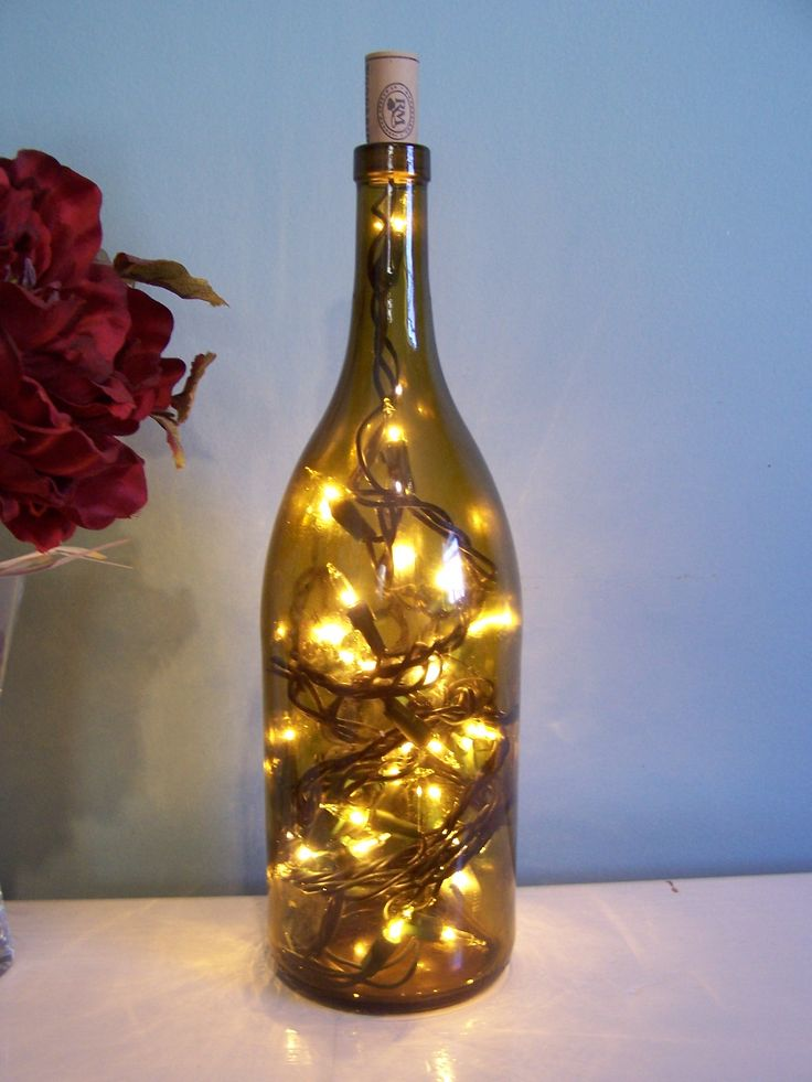 DIY Wine Bottle Lamps above kitchen