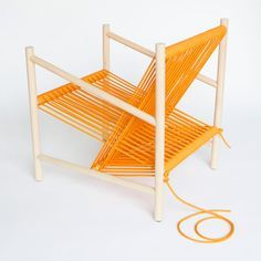 Using rope to incorporate textile techniques at a magnified scale, the Loom Chair, created by Laura Carwardine, combines the use of soft and hard materials frequently used in factory production. The seat and back support for this lounge chair are created from one continuous piece of orange rope, wrapped over a wooden dowel rod structure, as you would see in a traditional cloth loom. (1)
