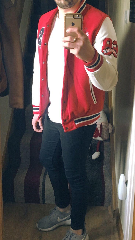 Oxking Red & White Men's Varsity Jacket: £28.99 Top Man Black Spray On Skinny Jeans: £30 Nike Grey Roshe One's: £70 River Island White Long Sleeve White T: £15