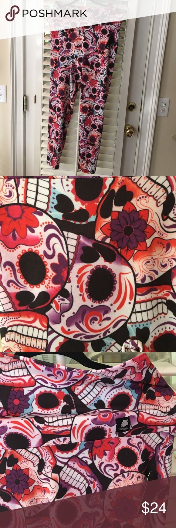NWT Day of dead skeleton 2x ankle yoga leggings These are so cool! NWT Lineage brand 2x ankle-length yoga pants. The Day of the Dead skeleton print in red and purple is amazing! Tall yoga waist band can be worn up or folded over. Very comfy and you'll be the envy of your workout group! Also would be fantastic under a black tunic. Lineage Pants Leggings