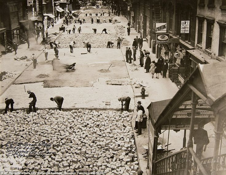 Building roads: Workers lay bricks to pave 28th Street in Manhattan on October 2, 1930.