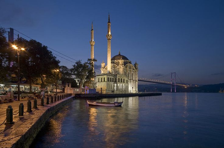 The Ortakoy Mosque And Bosphorus Bridge At Dusk by Ayhan Altun