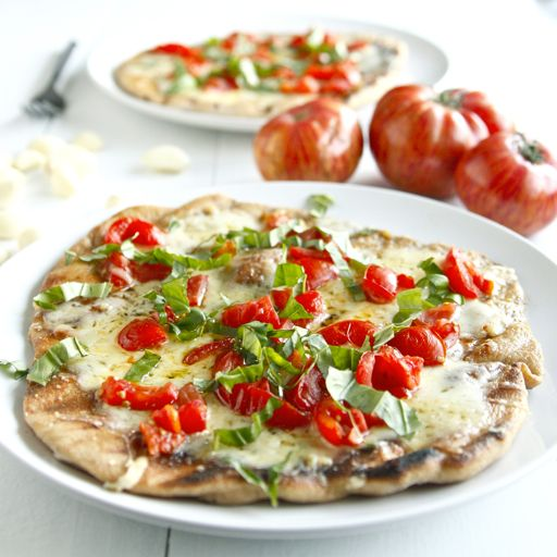 GRILLED Pizza w/ Chopped Basil, Fresh Tomatoes, & Fontina/Parmesan Cheese, ALL over a Whole Wheat Crust. @DishingTheDevineTomatoes Basil Pizza, Tomato Basil, Summer Pizza, Recipe, Olive Oils, Food, Long Kitchens, Grilled Tomatoes, Grilled Pizza