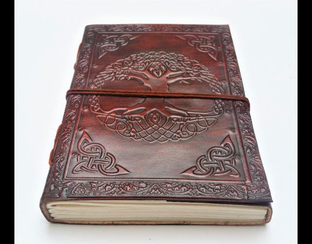 This beautiful hand made Tree of Life journal / notebook is made with plain handmade recycled paper bound by genuine leather.  The handmade sheets of paper are fixed with removable string binding...