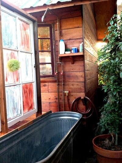 Outdoor bath using galvanized livestock trough- well why not? [But I think I would let guests think its some urban chic designer tub. :)