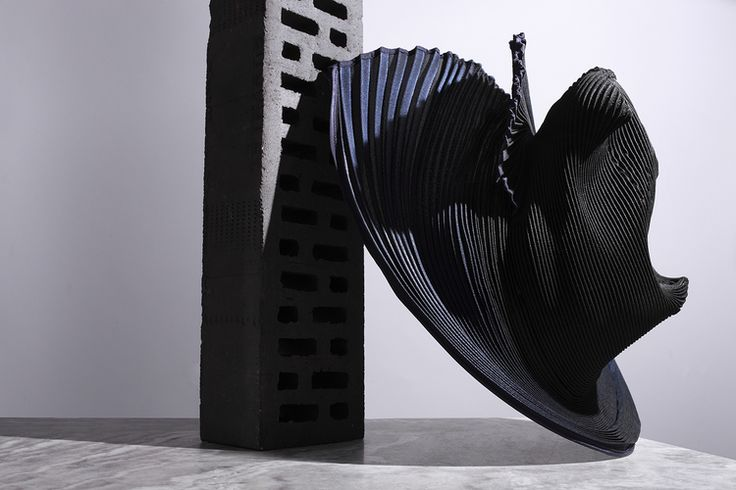 Pleated hat,   Issey Miyake    Photography by  Tom Hartford   Styling by  Alex Petsetakis