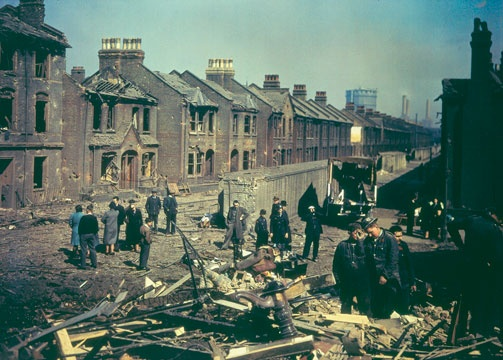 Inspecting bomb damage during the London Blitz, Battersea Power Station can be seen in the background.