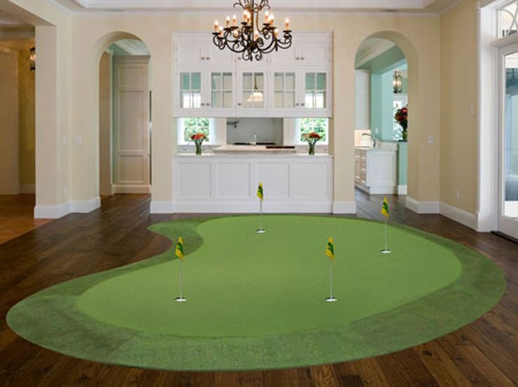 This indoor putting green mimics the gentle curve of a natural outdoor model, yet situated upon dark hardwood flooring, makes for refreshing experience in this central open living room space.
