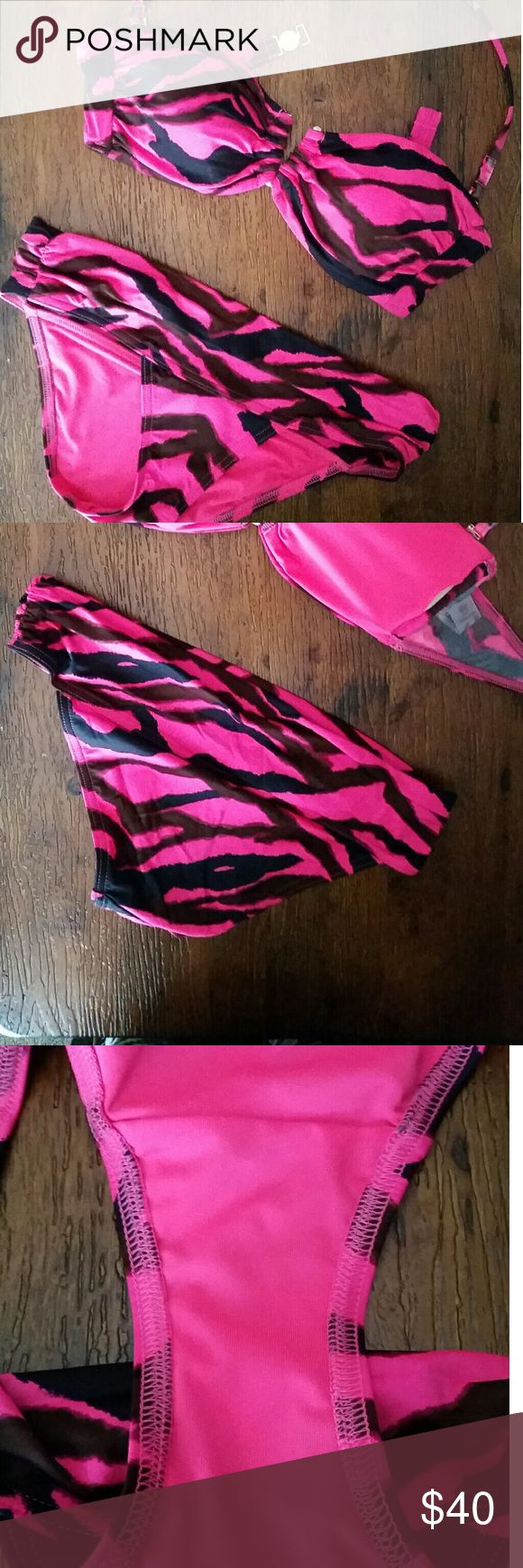 VS Bathing Suit Worn once! Victoria's Secret bathing suit Top: Bandeau - removable neck strap Size small  Bottom: Moderate coverage Low or mid rise Size XS  Hot pink and black zebra print Victoria's Secret Swim Bikinis