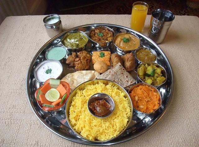 NORTH INDIAN THALI    Mint Chutney  Lime Pickle  Mango Chutney  Tomato, Carrot & Cucumber Salad  Pickled Shallots  Lemon Wedge  Red Onion Raitha  Punjabi Palak Paneer  Bombay Fish Masala   Mughlai Fish Korma  Jeera Potatoes  Carrot Halwa  Vegetable Samosa  Tandoori :) lovely! recipes on my website.