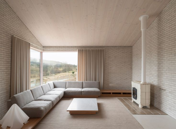The Living Room Area Of T Bywyd Life House Decorated In Neutral Tones Part Architecture Project