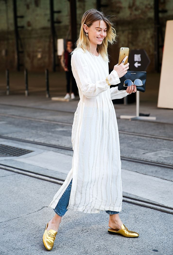 Browse the best summer street style outfit ideas at @stylecaster   white maxi dress, jeans, gold loafers