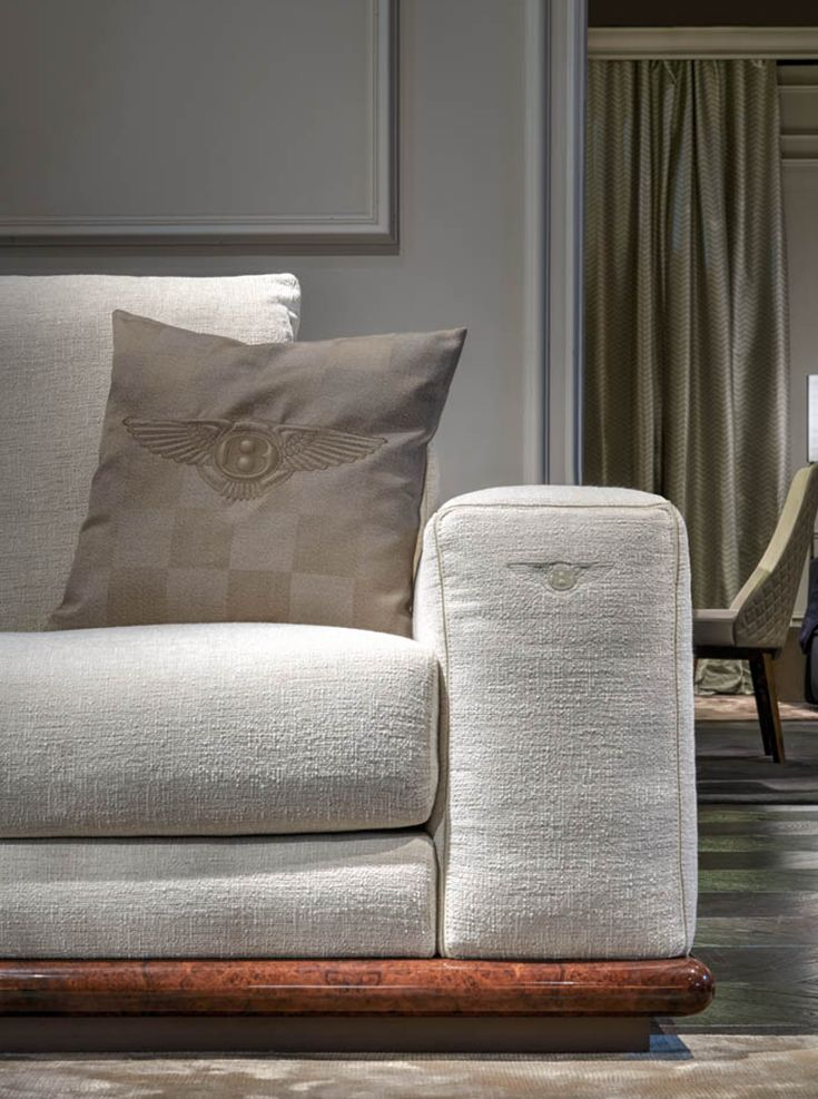 Benley Home's Wellington sofa looks comfortable and gracious. Look at the nice detail with the logo on the sofa, Luxury Living Group at Salone del Mobile Milano 2015