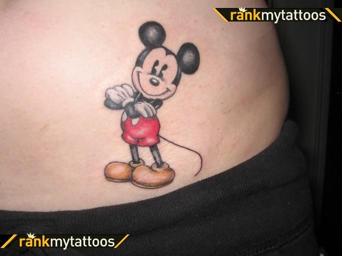 Mickey's arms crossed: great ink job on this mickey mouse tattoo!