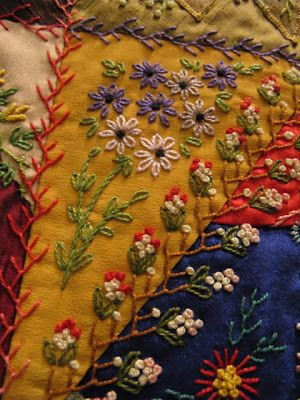 Embellishment on a crazy quilt. I would so do this if:  1) I lived on a deserted island; 2) had plenty of materials; 3) didn't have any hope of being rescued in the next 3 years or so. :-)