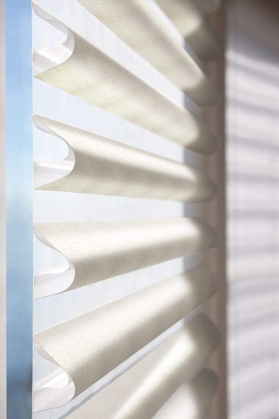 Satin Metallic fabric soft folds on a matching sheer facing. Luxaflex® Pirouette® Shadings exclusively from Luxaflex® Window Fashions