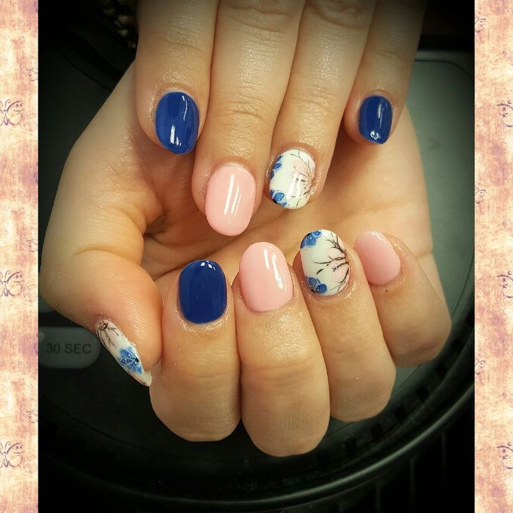 Oval Acrylic Nails with Spring-Theme Designs by Andy Hai ...