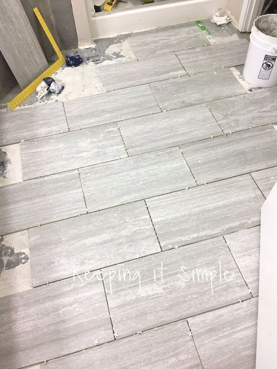 How To Tile A Bathroom Floor With 12x24 Gray Tiles Grey Bathroom Floor Bathroom Flooring Bathrooms Remodel