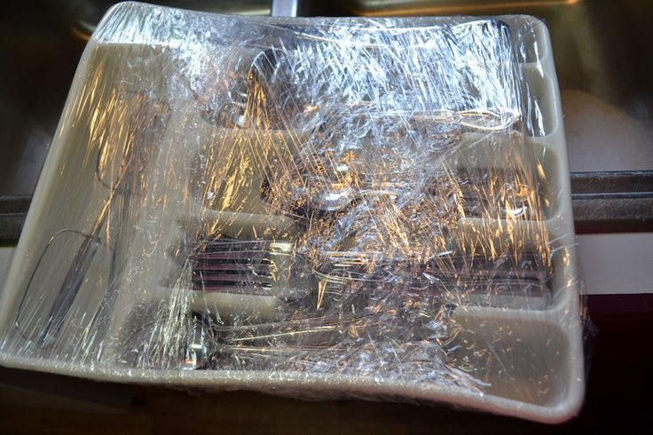 Moving Tip: Use shrinkwrap to wrap your silverware in its holder.... this tip also works for dresser drawers if you remove them. (It will save your husband's back and make unpacking super easy too)