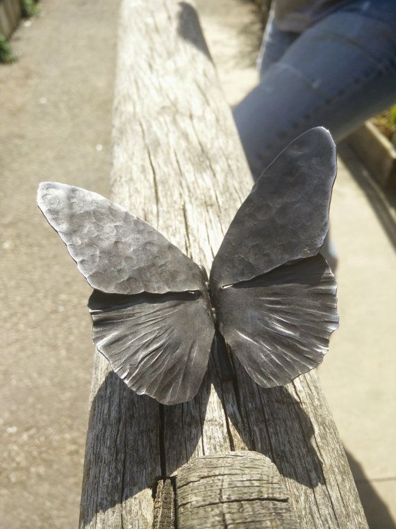 This is a hand forged butterfly. It is about 10 cm wing tip to wing tip. Optionally you can choose the Stainless steel option with has a nail hanger and can hang on the wall. Each item is handmade and so each of the butterflies may be slightly different.
