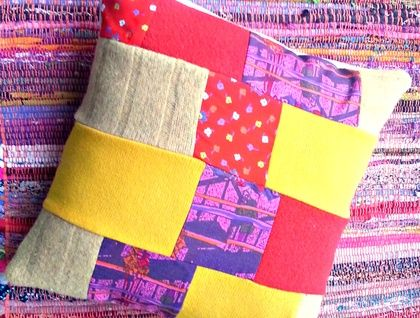 Bright Patchwork Cushion - Eco Friendly Reclaimed wool and fabric. One of a kind https://cherryberry.felt.co.nz