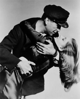 "Bogart and Bacall--He adored her. Lauren coined the title, 'The Rat Pack""--their social gang that hung together; it was cont. and adopted by it's notorious member, Frank Sinatra."