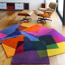 fun geometric rug. for a kids room or a family game/media room?