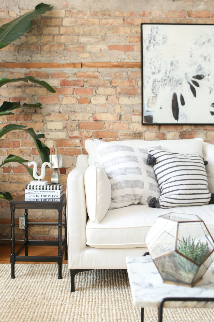 Neutral Chicago apartment with exposed brick: Read More on SMP: http://www.stylemepretty.com/living/2016/06/07/why-decorating-with-neutrals-will-never-ever-go-out-of-style/