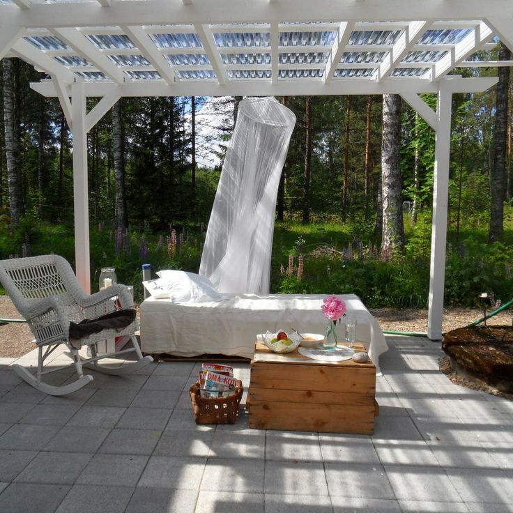 Nice outdoor bed.... Side of house  covered pergola in white