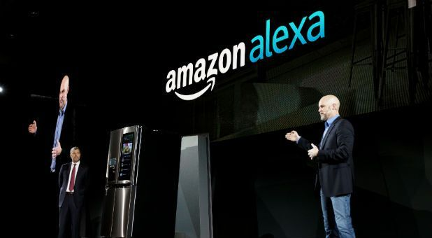 David VanderWaal, VP of marketing for LG Electronics USA (L), listens to Mike George, VP Alexa, Echo and Appstore for Amazon, talking about their companies' partnership during the LG press conference at CES in Las Vegas.
