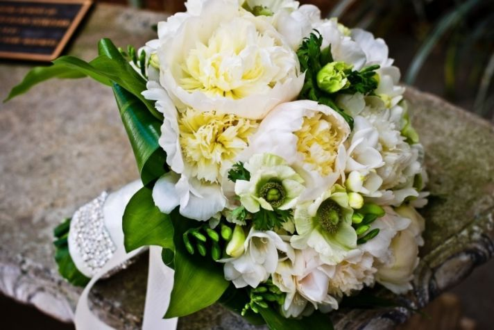 10 white wedding flowers we love bowl of cream peonies wedding centerpiece green accents